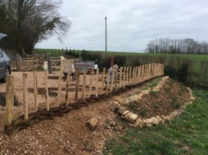 positioning the chestnut posts and starting the weave