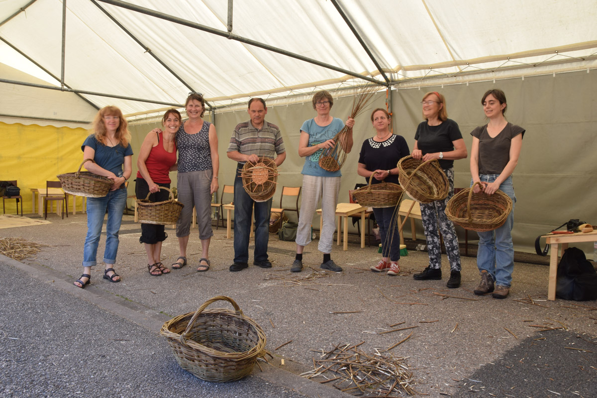 students holding their finished baskets