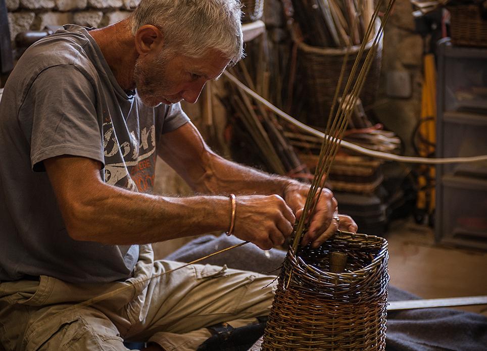 adrian working on a basket